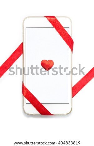 White cellphone wrapped with strip of red ribbon, with small red heart placed in the center on white background, contain slight drop shadow, good for valentine's day or special occasions - stock photo