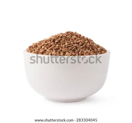 White ceramic bowl full of the buckwheat seeds isolated over the white background - stock photo