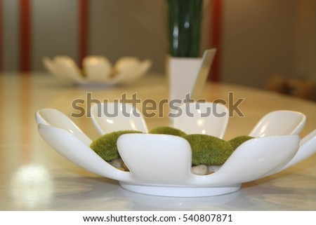 White ceramic bowls on long marble table