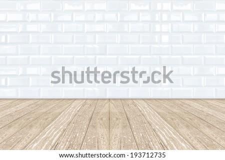 White Ceramic brick tile wall and light wooden floor - stock photo