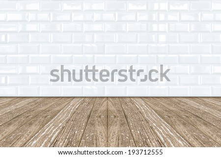 White Ceramic brick tile wall and wooden floor - stock photo