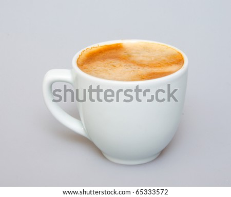 White ceramic cup from coffee on a white background - stock photo