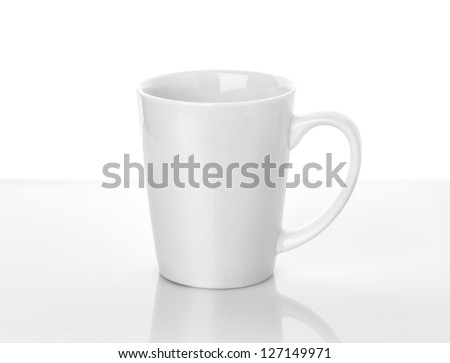 White ceramic cup stands on table above white background - stock photo