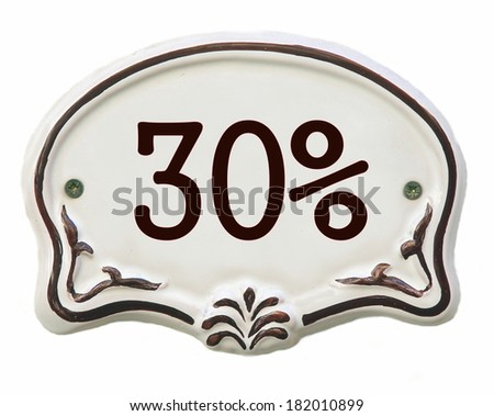 White ceramic decorated tile showing 30 %  discount  - stock photo