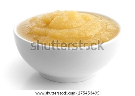 White ceramic dish of apple sauce on white. - stock photo