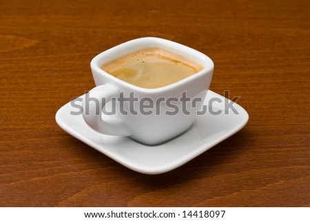 White ceramic espresso coffee cup and saucer on wood table - stock photo