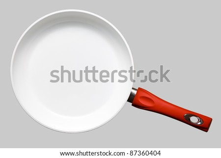 White ceramic frying pan on gray background. - stock photo