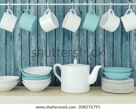 White ceramic kitchenware on the wooden shelf in front of blue old wood wall. - stock photo