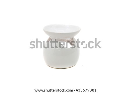 White ceramic vase candlesticks  for aromatic oil isolated on the white background.