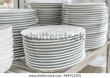 white ceramics plate and empty white bowl