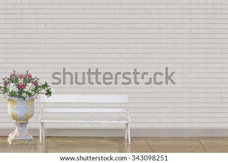 white chair and outdoor flower vase at  white brick wall  - stock photo