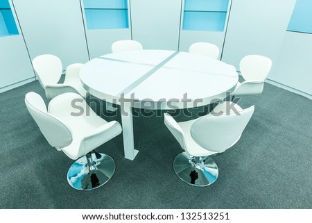 white chair and tables set for reading in the empty library - stock photo