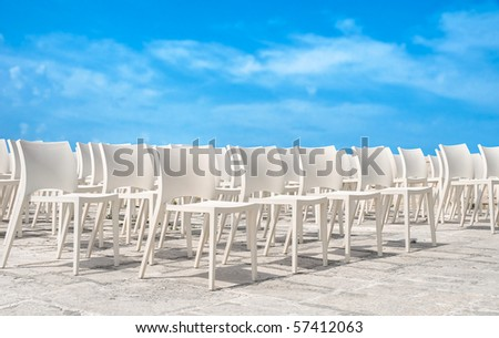 White chair group on blue sky. - stock photo