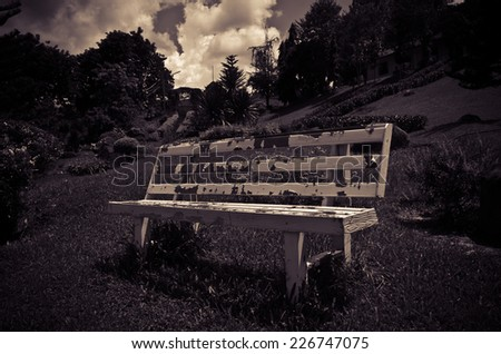 White chair in park, no people - stock photo
