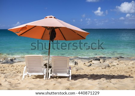 White chairs and, umbrella on a beach on Sint Maarten