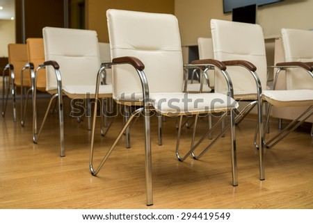 white chairs in a row in conference room  - stock photo
