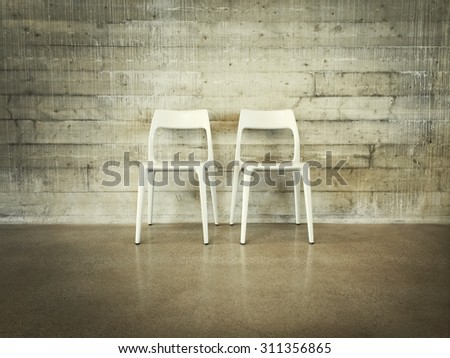 White chairs near concrete wall, modern industrial design. - stock photo