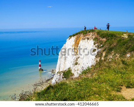 White chalk cliffs and aerial view of the Beachy Head Lighthouse, Eastbourne, East Sussex, England - stock photo