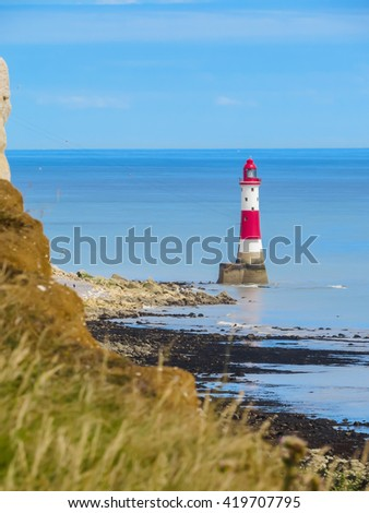 White chalk cliffs and Beachy Head Lighthouse. Eastbourne, East Sussex, England - stock photo