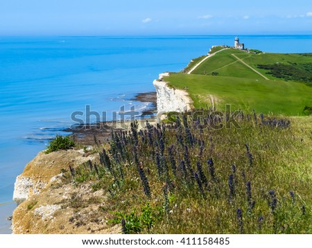 White chalk cliffs and the Belle Tout Lighthouse, Eastbourne, East Sussex, England - stock photo
