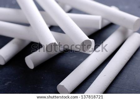 white chalks on the blackboard - stock photo