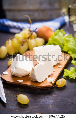 white cheese, grape and lettuce with white wine