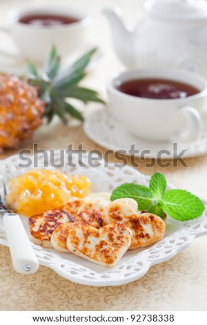 White cheese, grilled and served with pineapple jam for breakfast, selective focus - stock photo