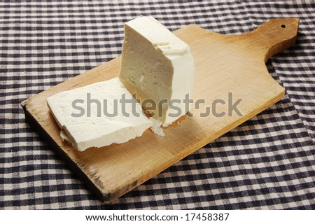 White cheese on wood plate