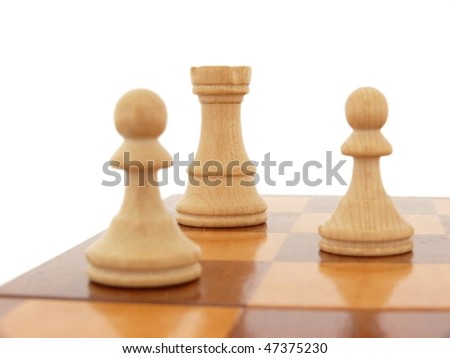 White chess figures on a chessboard isolated on white - stock photo