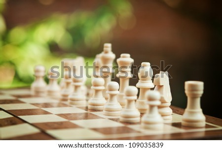 white chess pieces on the board - stock photo