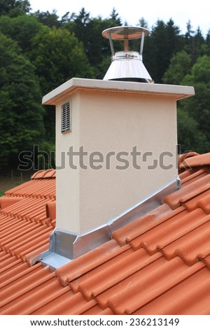 White chimney on the roof covered with new red concrete tiles - stock photo