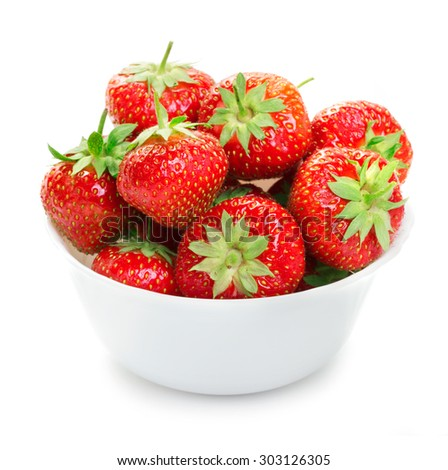 white china bowl filled with ripe strawberries - stock photo