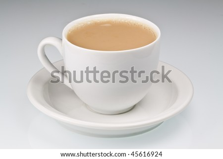 White china cup of tea with milk on a plain background - stock photo
