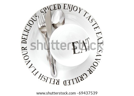 White China plate and pudding bowl with text and silver cutlery isolated on a white background - stock photo