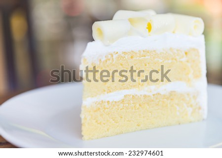 White chocolate cake in white plate - close up selective shot - stock photo