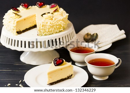 White chocolate cheesecake with brownie crust with white chocolate cream cheese filling, covered in white chocolate ganache. - stock photo