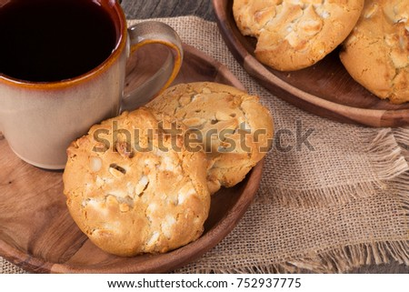 White chocolate macadamia nut cookies and cup of coffee