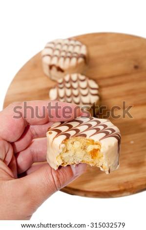 White chocolate muffin in the hand. - stock photo
