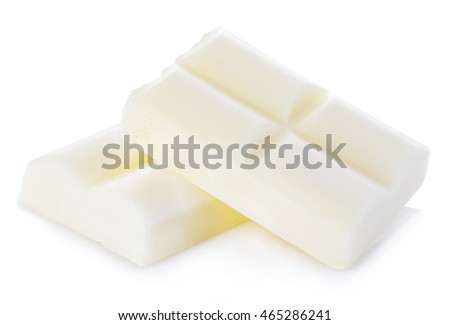 White chocolate pieces close-up isolated on a white background.