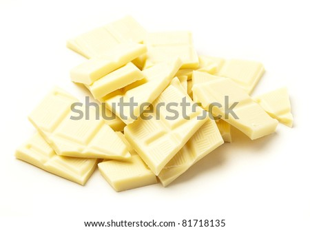 white chocolate pieces isolated on a white background - stock photo