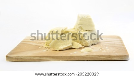 White chocolate pieces isolated on clear background - stock photo