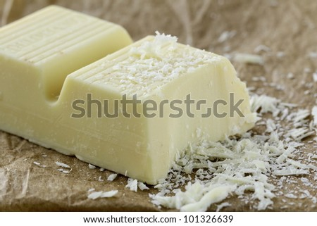 white chocolate pieces on a wooden board - stock photo