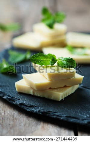 White chocolate with mint, selective focus