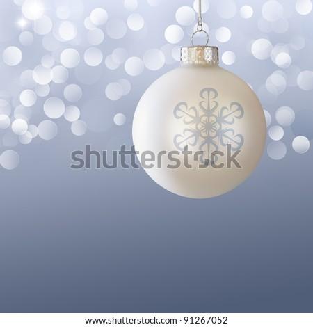 White Christmas Ball Ornament Over Elegant Blue Gray Blurred Christmas Light Bokeh Background - stock photo