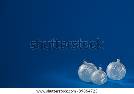 White christmas baubles with stars over blue background. - stock photo