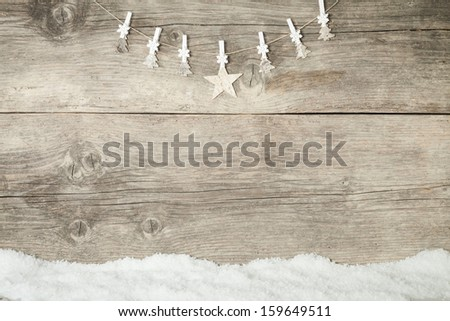 white Christmas decoration on wooden background with snowflake - stock photo