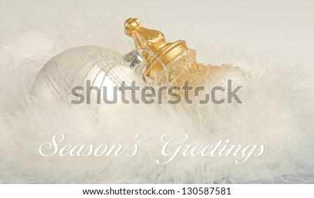 White Christmas ornaments with Season's Greetings message. - stock photo
