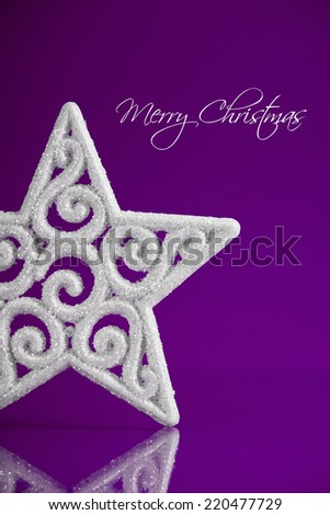 White christmas star on dark purple xmas background with space for text - stock photo