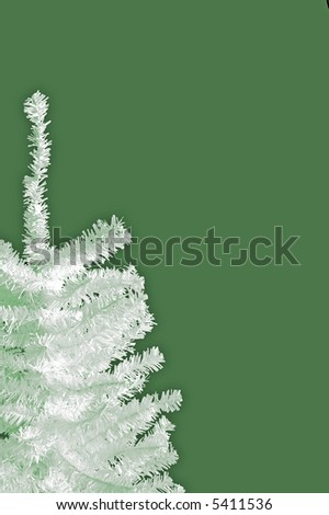 White Christmas tree on green background