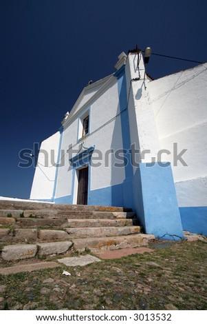 White church agains deep blue sky - stock photo